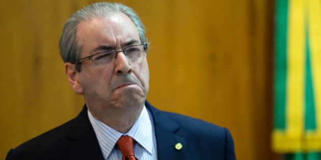 The president of the Brazilian Chamber of Deputies, Eduardo Cunha, gestures during breakfast with journalists...