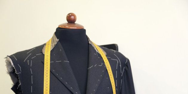 Jacket in the process of being tailored shot on white background. The jacket has been worn on a mannequin...