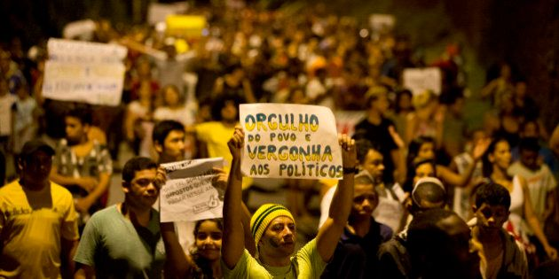 A protester holds a sign that reads in