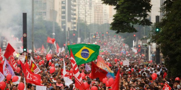 Demonstrators attend a protest in support of Brazil's President Dilma Rousseff and former President Luiz...