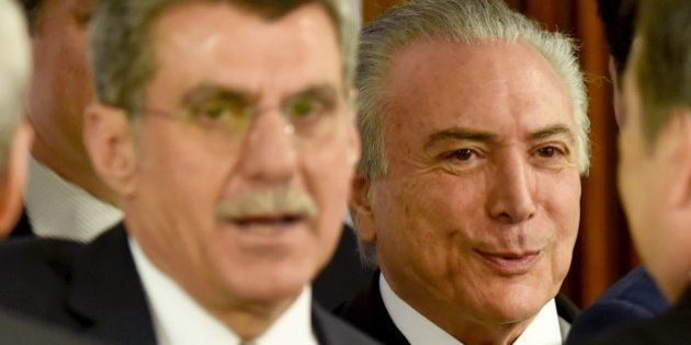 Acting Brazilian President Michel Temer (R) and Romero Juca, a former minister of planning who left the...