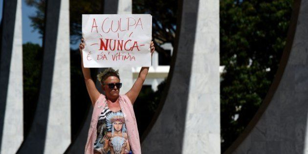 Brazilians protest outside the Supreme Court in Brasilia on May 29, 2016, against the recent gang-rape...