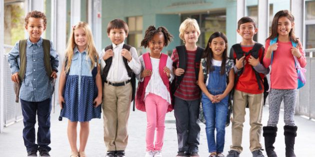 Group of elementary school kids standing in school
