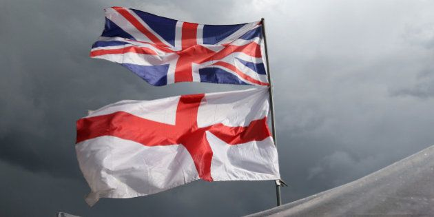 The flag of the United Kingdom of Great Britain and Northern Ireland, top, and the flag of England fly...