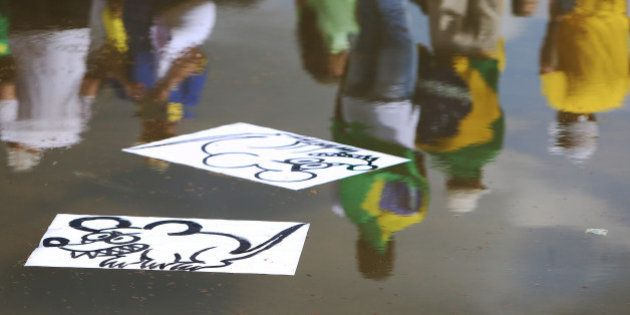 Drawings that represent rats are pictured in front of the National Congress during a protest against...
