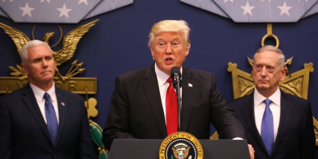 U.S. President Donald Trump (C) dellivers remarks after attending a swearing-in ceremony for Defense...