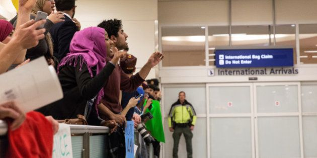 People chant as they gather in protest against the travel ban imposed by U.S. President Donald Trump's...