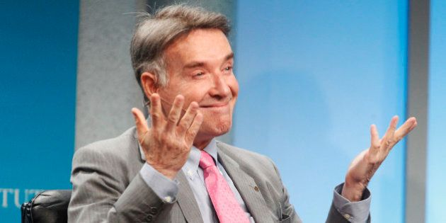 Brazilian Eike Batista, chairman and CEO of EBX Group, gestures as he is introduced as one of the world's...