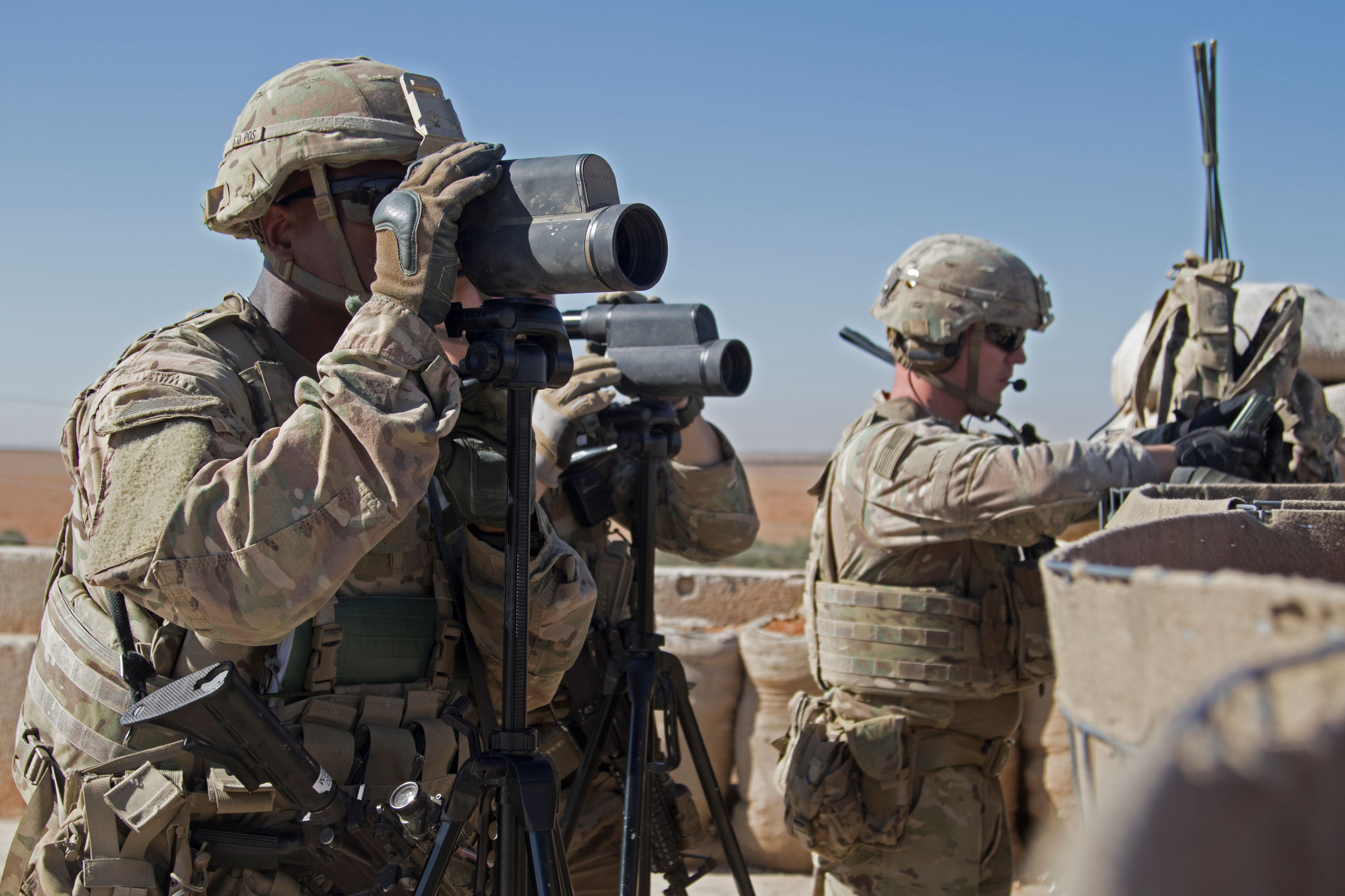 U.S. Soldiers surveil the area during a combined joint patrol in Manbij, Syria, November 1, 2018. Picture taken November 1, 2018. Courtesy Zoe Garbarino/U.S. Army/Handout via REUTERS   ATTENTION EDITORS - THIS IMAGE HAS BEEN SUPPLIED BY A THIRD PARTY.