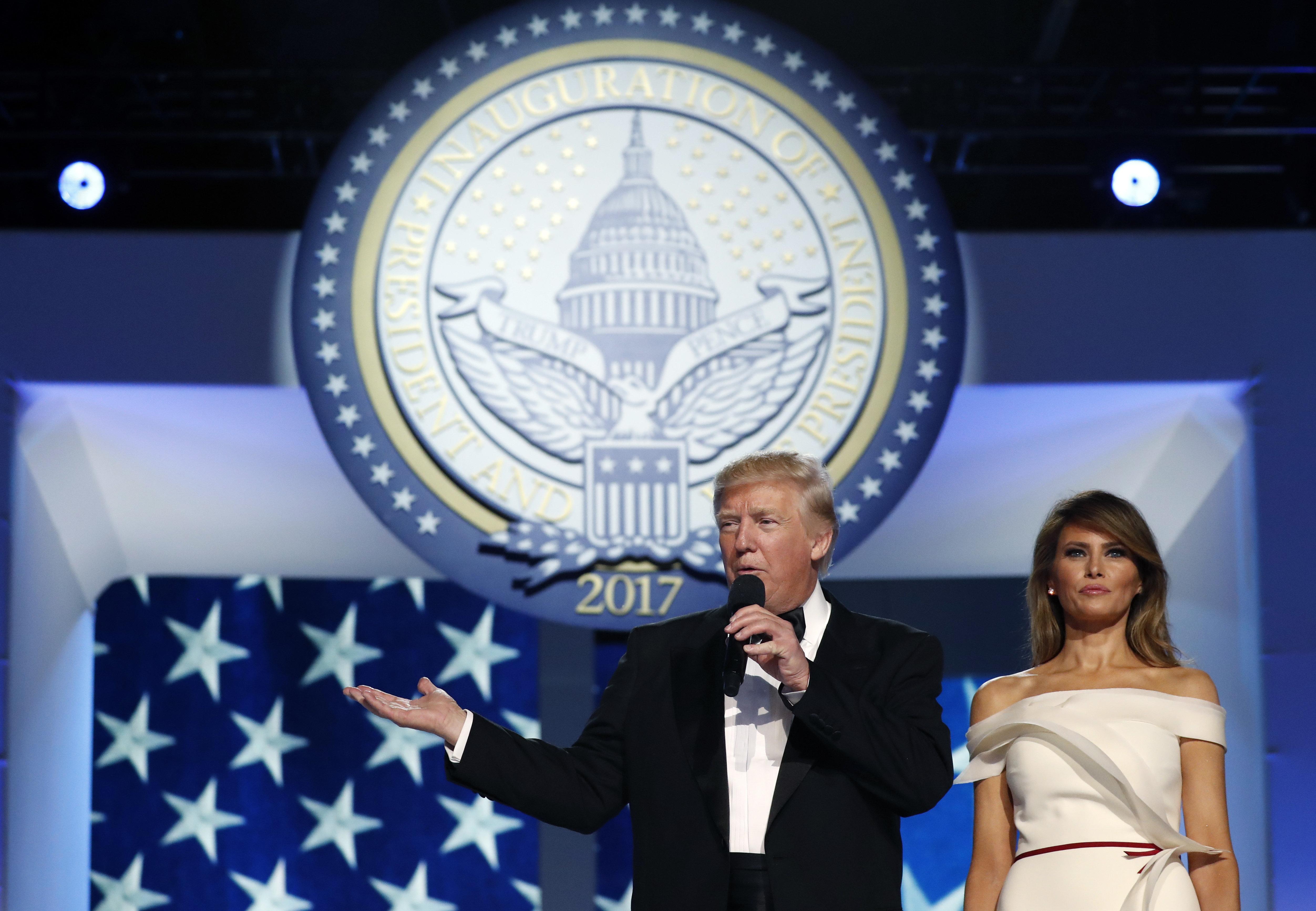 President Donald Trump talks as first lady Melania Trump listens at the Freedom Ball, Friday, Jan. 20, 2017, in Washington. (AP Photo/Alex Brandon)