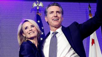 Lt. Gov Gavin Newsom, a Democrat, hugs his wife,Jennifer Siebel Newsom as he celebrates at an election night party after he defeated Republican opponent John Cox to become 40th governor of California Tuesday, Nov. 6, 2018, in Los Angeles, Calif. (AP Photo/Rich Pedroncelli)