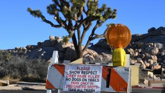 Signs placed by staff at a closed campground in the Joshua Tree National Park after the federal government's partial shutdown caused park rangers to stay home and campgrounds to be shut, at the park in California on January 3, 2019. - US President Donald Trump warned the US federal government may not fully reopen any time soon, as he stood firm on his demand for billions of dollars in funding for a border wall with Mexico. (Photo by Mark RALSTON / AFP)        (Photo credit should read MARK RALSTON/AFP/Getty Images)