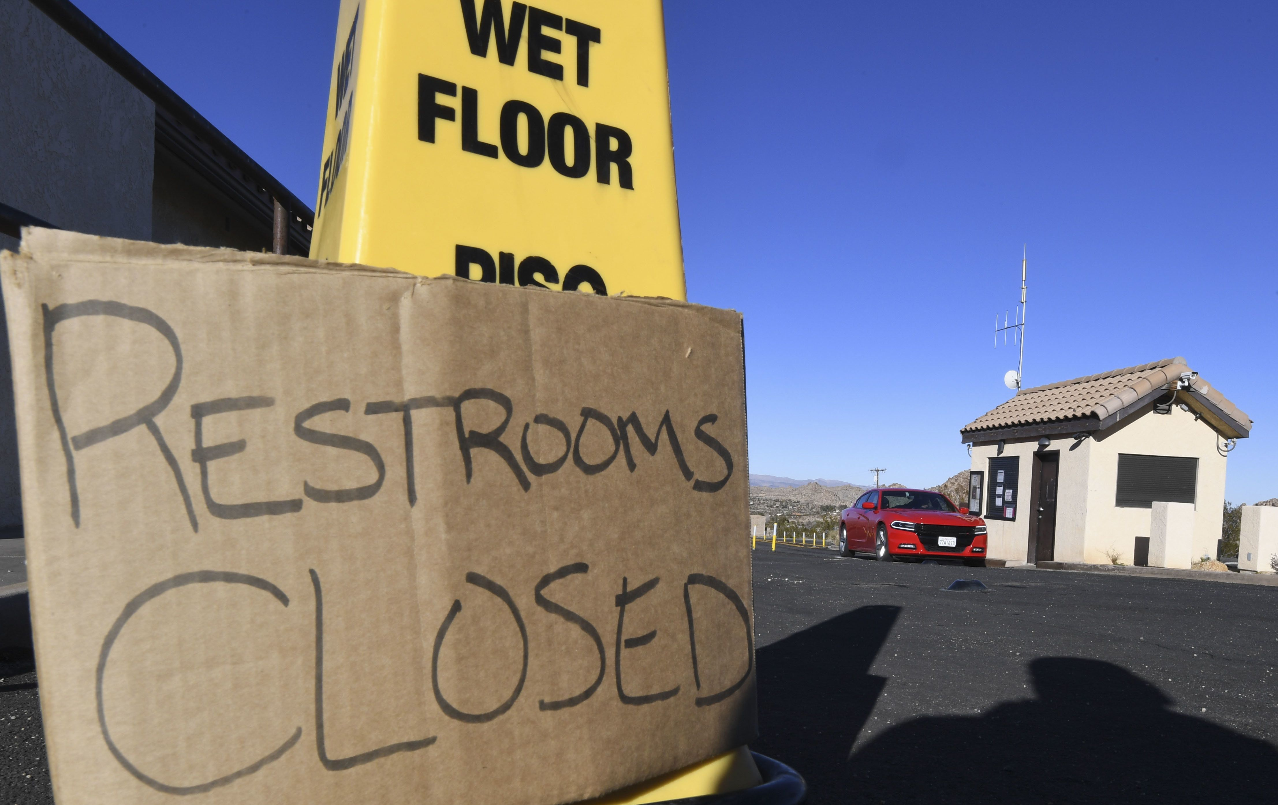 Tourists drive past the closed entrance ticket station of California's Joshua Tree National Park on Jan. 3.