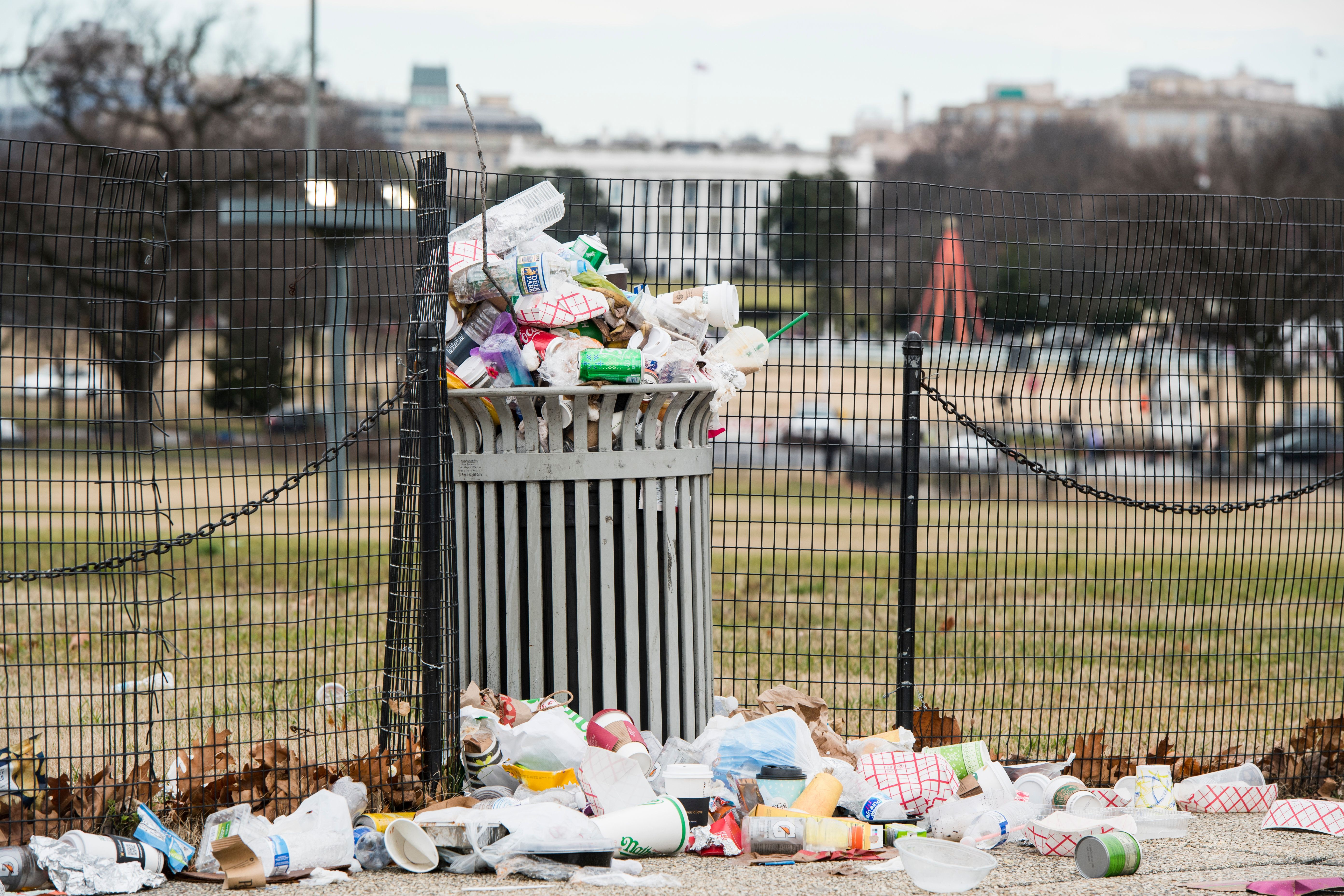 Garbage overflows from a trash can on the National Mall across from the White House on Jan. 1, 2019.
