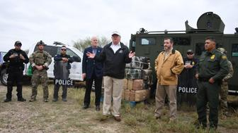 US President Donald Trump speaks after he received a briefing on border security next to Sen. John Cornyn(L) R-TX and Sen. Ted Cruz(2ndR) R-TX near the Rio Grande in McAllen, Texas, on January 10, 2019. - Trump travelled to the US-Mexico border as part of his all-out offensive to build a wall, a day after he stormed out of negotiations when Democratic opponents refused to agree to fund the project in exchange for an end to a painful government shutdown. (Photo by Jim WATSON / AFP)        (Photo credit should read JIM WATSON/AFP/Getty Images)