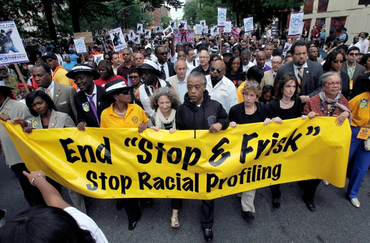 In this June 17, 2012, file photo, the Rev. Al Sharpton, center, walks with demonstrators during a silent march to end New Yo