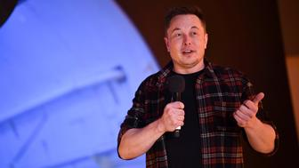 "Tesla Inc. founder Elon Musk speaks at the unveiling event by ""The Boring Company"" for the test tunnel of a proposed underground transportation network across Los Angeles County, in Hawthorne, California, U.S. December 18, 2018.        Robyn Beck/Pool via REUTERS"