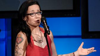 Janeane Garofalo addresses the crowd during the 11th Annual Hollywood Awards Gala Ceremony in Beverly Hills, Calif., Monday, Oct. 22, 2007. (AP Photo/Chris Pizzello)