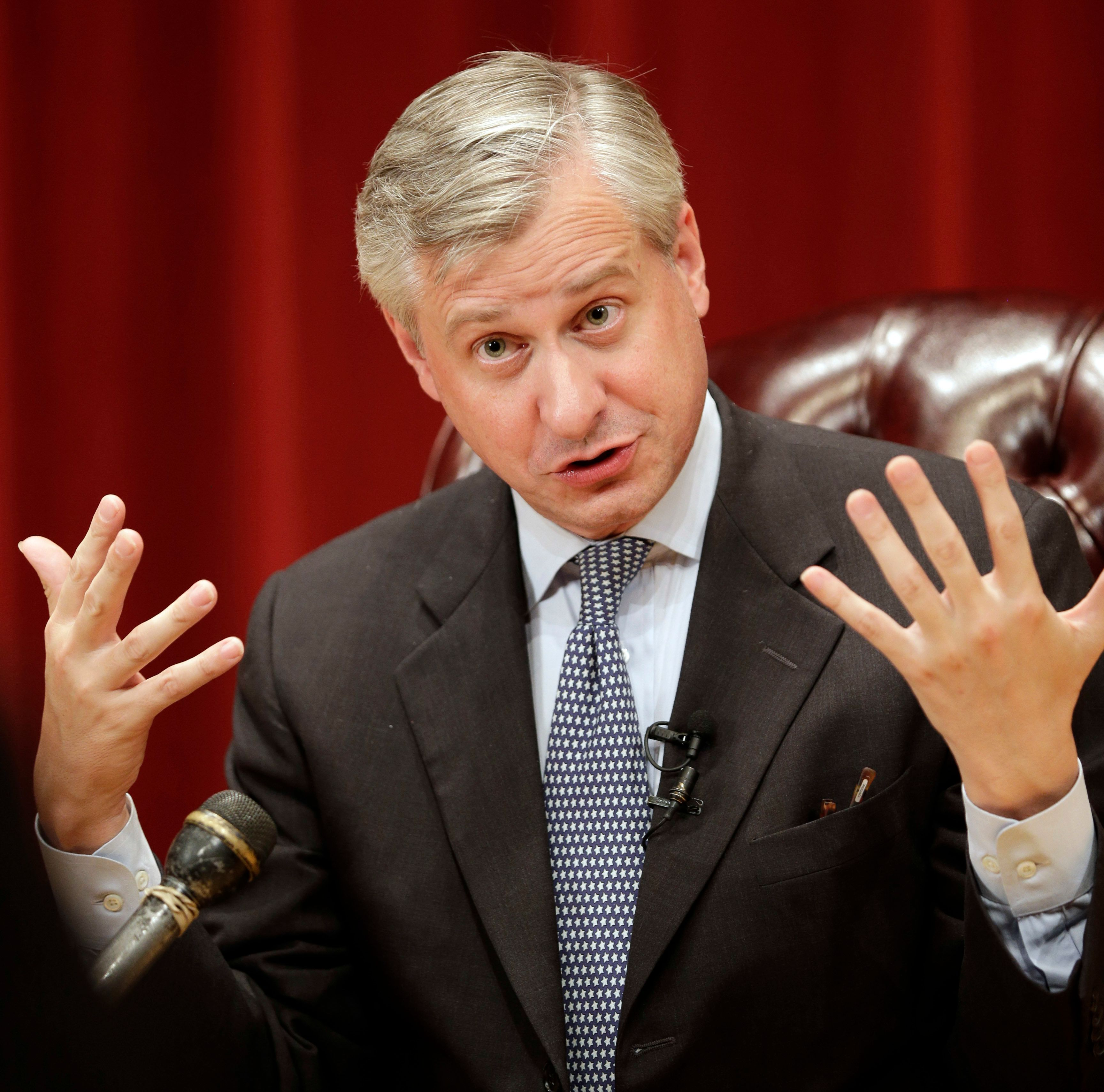 """Author Jon Meacham answers a question from reporters before an event at Texas A&M University to launch his latest book """"Destiny and Power: The American Odyssey of George Herbert Walker Bush"""" Monday, Nov. 9, 2015, in College Station, Texas. The book will be released nationwide Tuesday. (AP Photo/David J. Phillip)"""