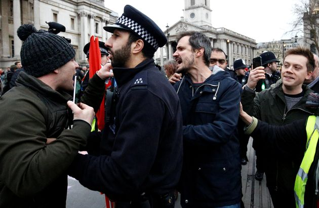 Owen Jones, far right in this picture, was escorted by police as he attended an anti-cuts demo in London on Saturday.