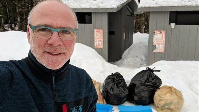 Dan Little , husband of Oregon Gov. Kate Brown, tackles the loos at Mt. Hood during government shutdown.