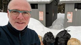 Dan Little , husband of Oregon Gov. Kate Brown, tackles the loos at Mt. Hood during government shutdown.