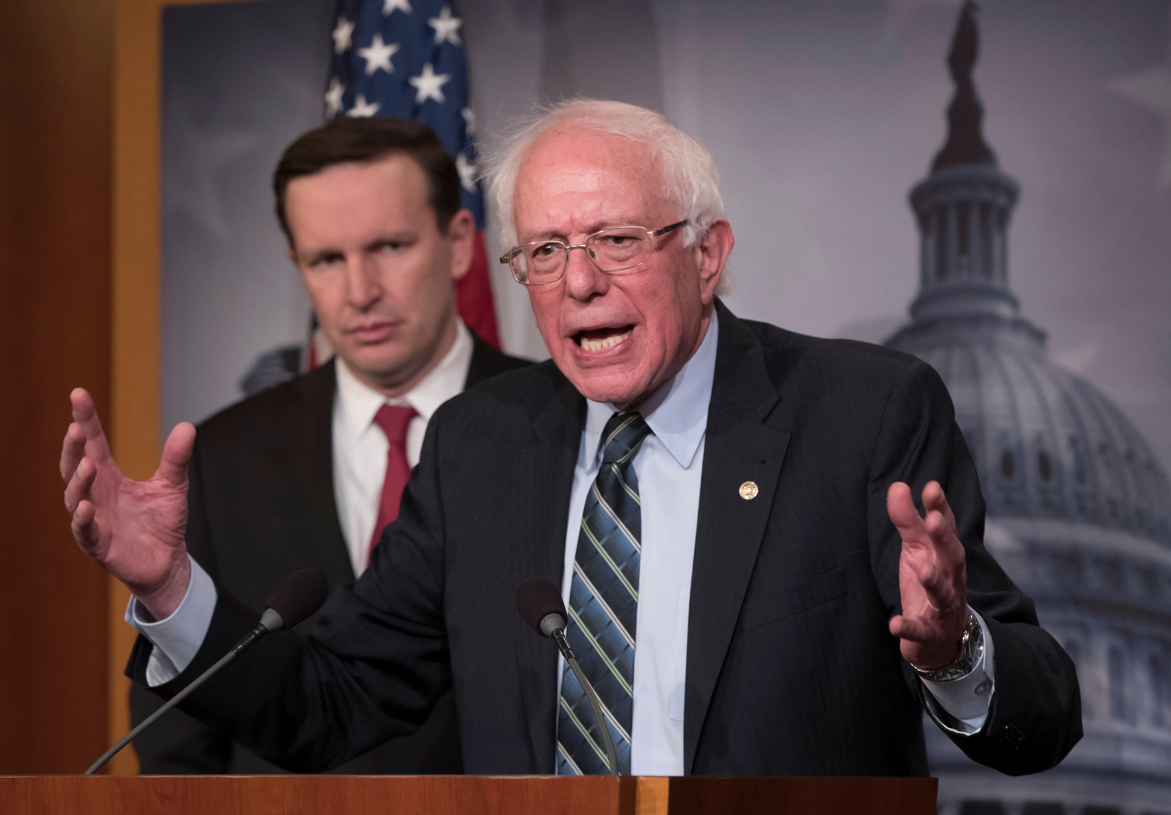 Sen. Bernie Sanders, I-Vt., joined at left by Sen. Chris Murphy, D-Conn., holds a news conference after the Senate passed a resolution he introduced that would pull assistance from the Saudi-led war in Yemen, a measure to rebuke Saudi Arabia after the killing of journalist Jamal Khashoggi, at the Capitol in Washington, Thursday, Dec. 13, 2018. (AP Photo/J. Scott Applewhite)