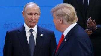 BUENOS AIRES, ARGENTINA - NOVEMBER 30: (RUSSIA OUT) Russian President Vladimir Putin (L) looks at U.S. President Donald Trump during the welcoming ceremony prior to the G20 Summit's Plenary Meeting on November 30, 2018 in Buenos Aires, Argentina. U.S. President Donald Trump cancelled his meeting with Vladimir Putin at the G20 Summit in Argentina planned for Saturday. (Photo by Mikhail Svetlov/Getty Images)