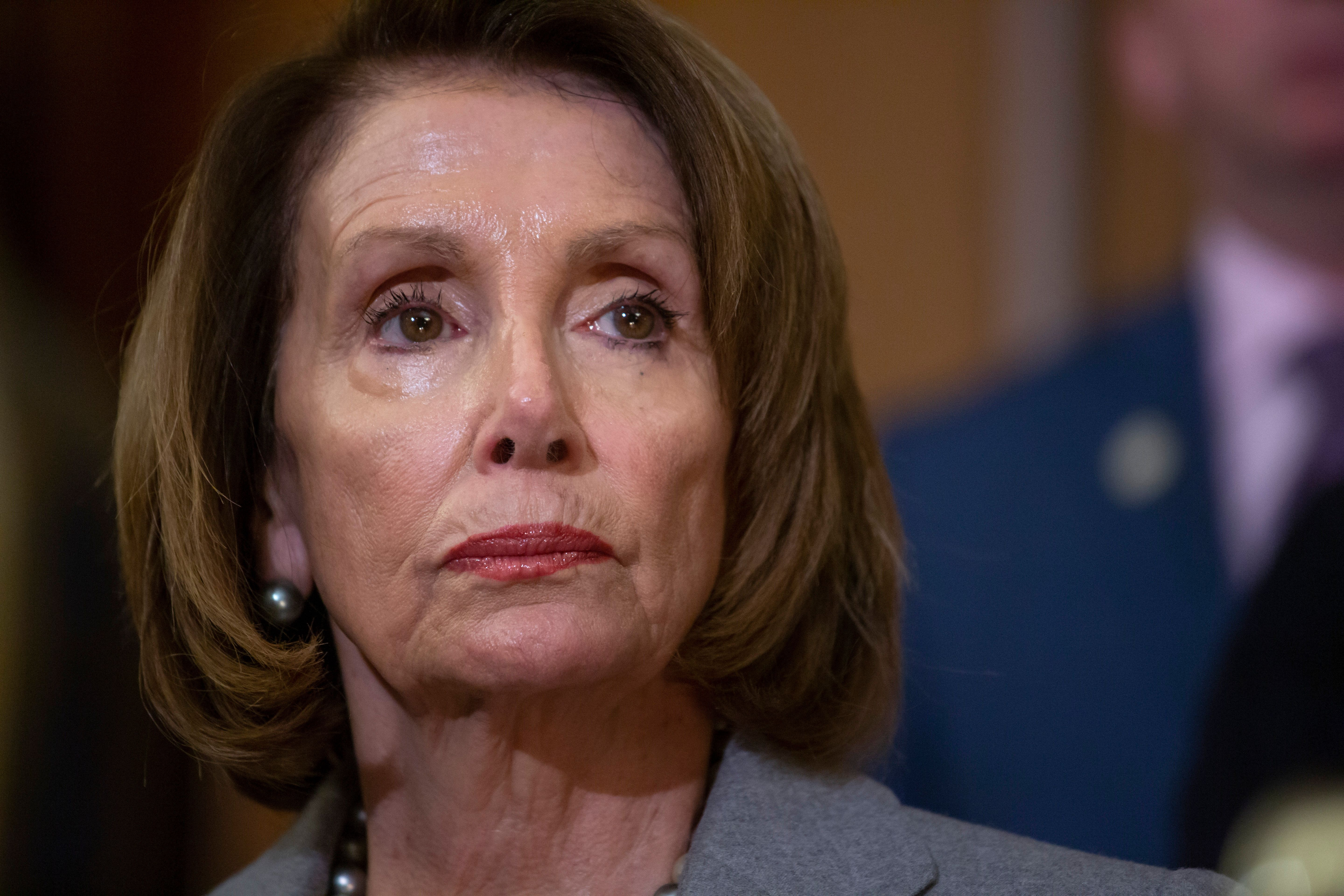 Speaker of the House Nancy Pelosi, D-Calif., meets with furloughed federal workers at an event to discuss the impact on families from the partial government shutdown and President Donald Trump's demands for funding a U.S.-Mexico border wall, on Capitol Hill in Washington, Wednesday, Jan. 9, 2019. (AP Photo/J. Scott Applewhite)