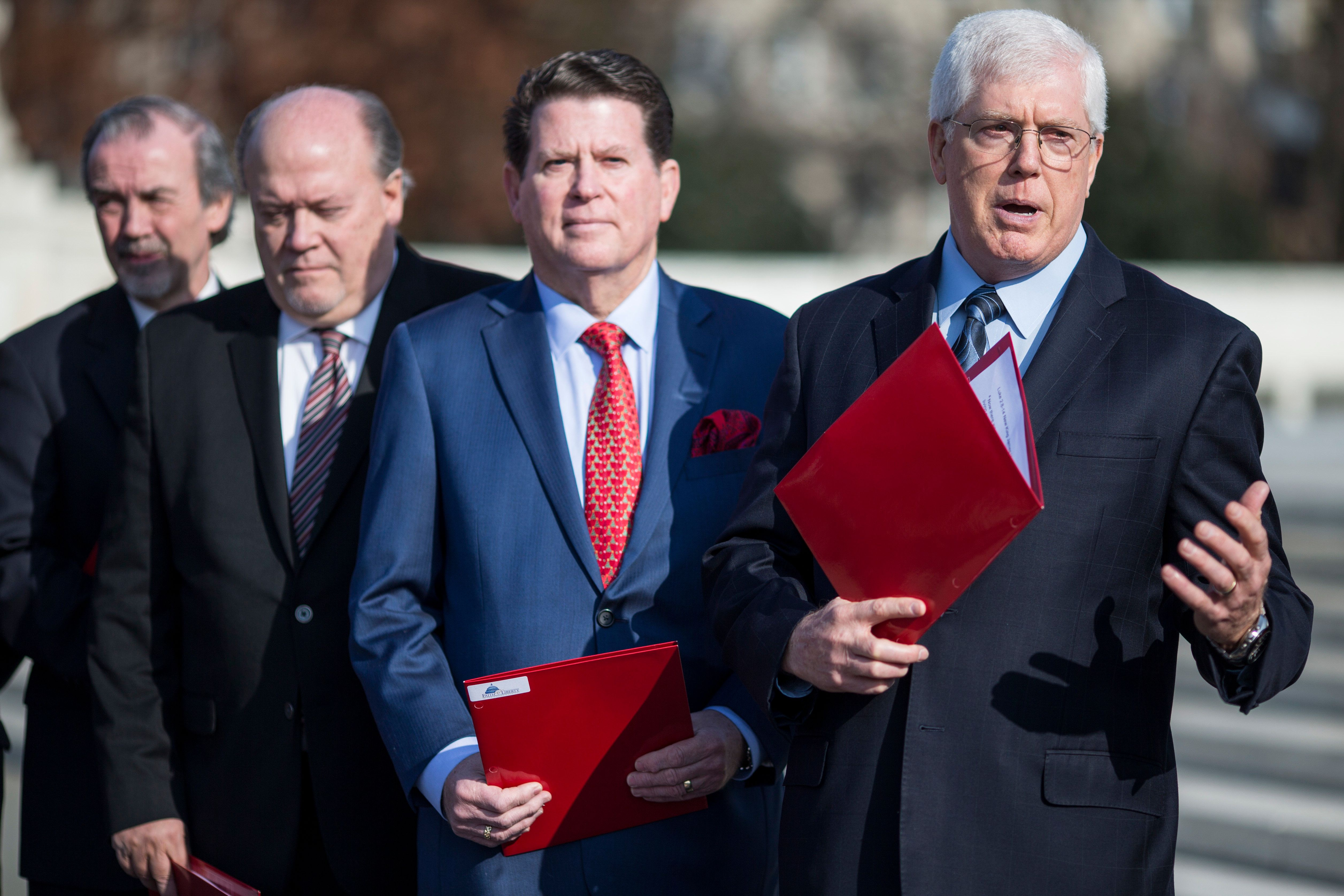 Mat Staver (far right), the founder of Liberty Counsel, at a demonstration outside the Supreme Court in December. The group o