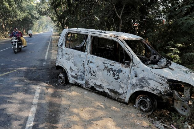 A vehicle that was burnt by a mob during violence in