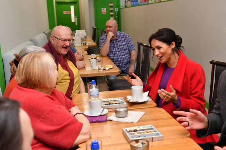 "The Duchess of Sussex speaks with local people at Number 7, a ""Feeding Birkenhead"" citizens supermarket and community cafe, a"