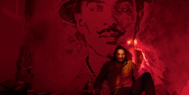 Actor Jiiva against a poster of Bhagat Singh inthe teaser of upcoming Tamil film