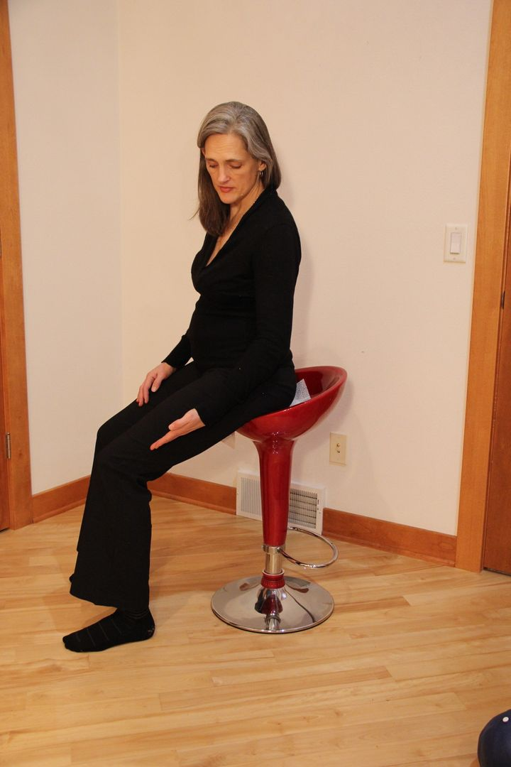 Hilary Bryan demonstrates saddle height on a stool.