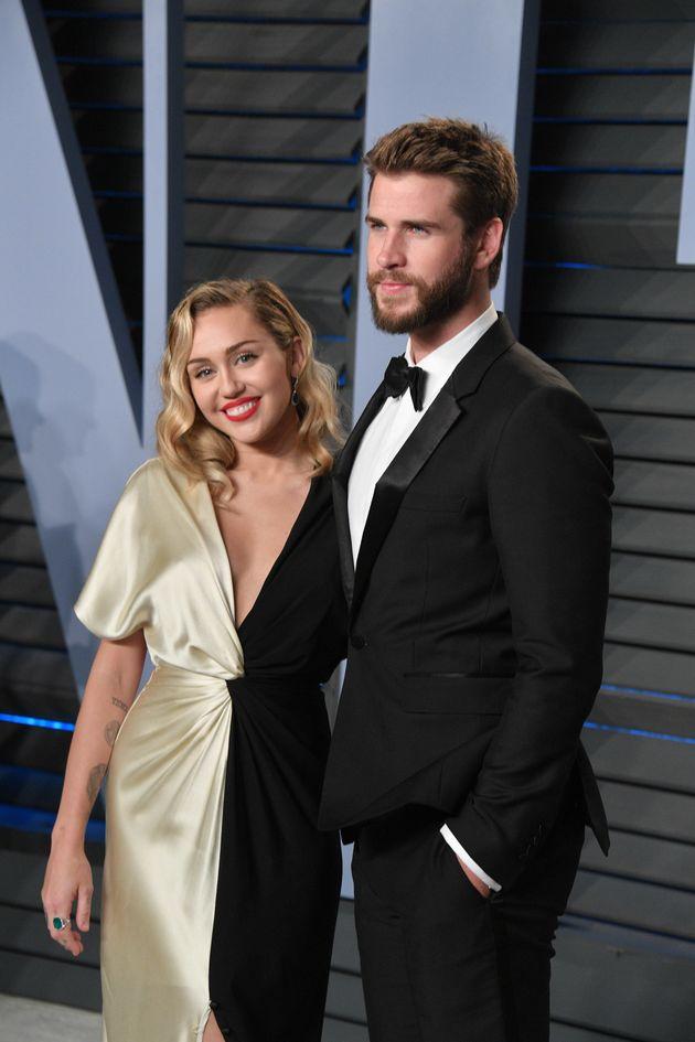 Miley Cyrus and Liam Hemsworth arrive at the 2018 Vanity Fair Oscar