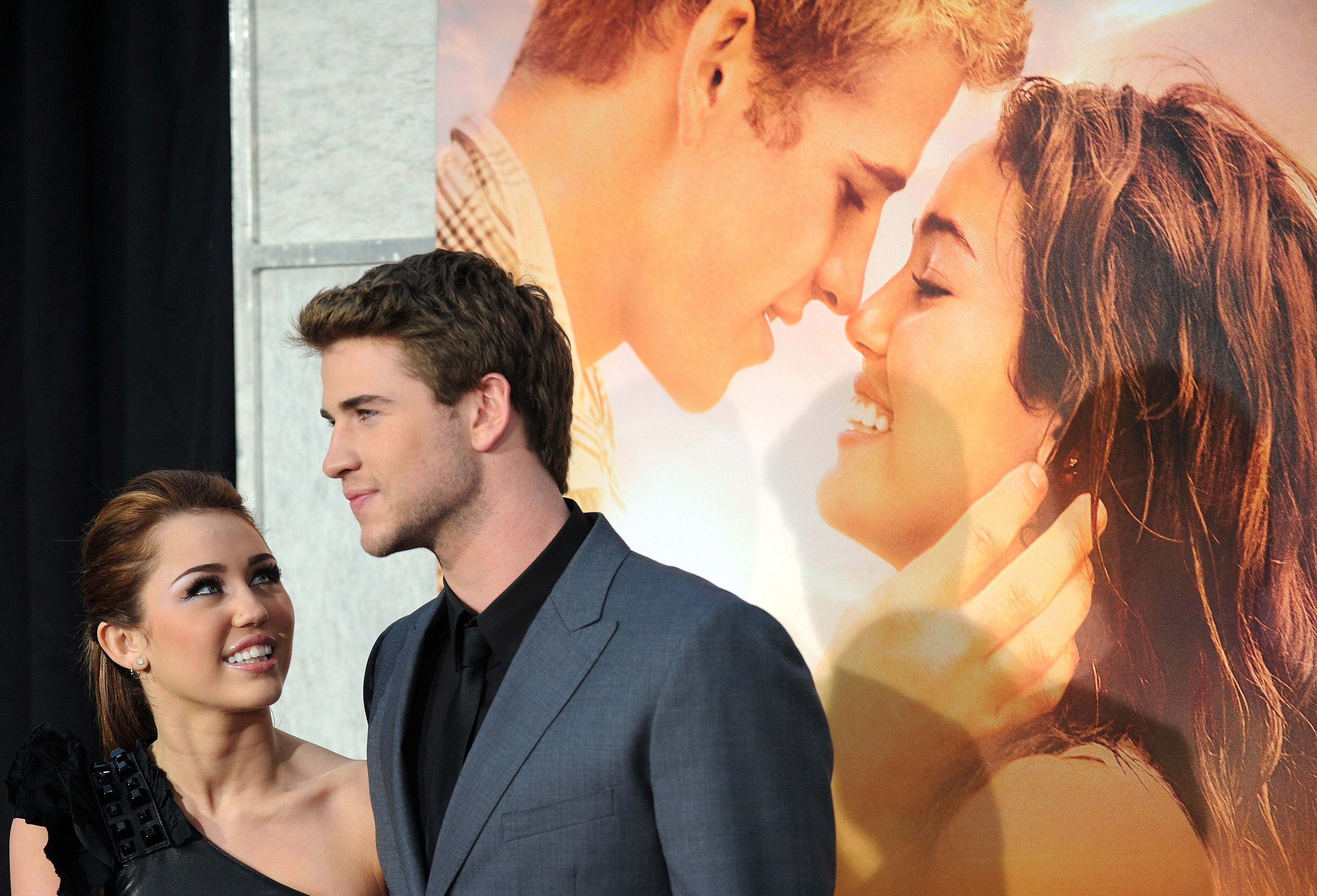 Actress and singer Miley Cyrus and actor Liam Hemsworth arrive for the premiere of 'The last song' in Hollywood, California on March 25, 2010. AFP PHOTO / GABRIEL BOUYS (Photo credit should read GABRIEL BOUYS/AFP/Getty Images)