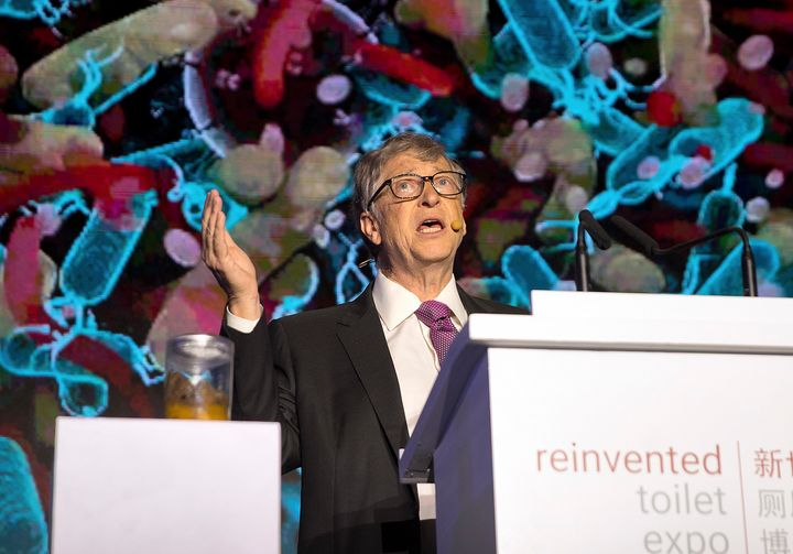 Bill Gates stands next to a jar of feces as he addresses delegates at the Reinvented Toilet Expo in China in November 2018.