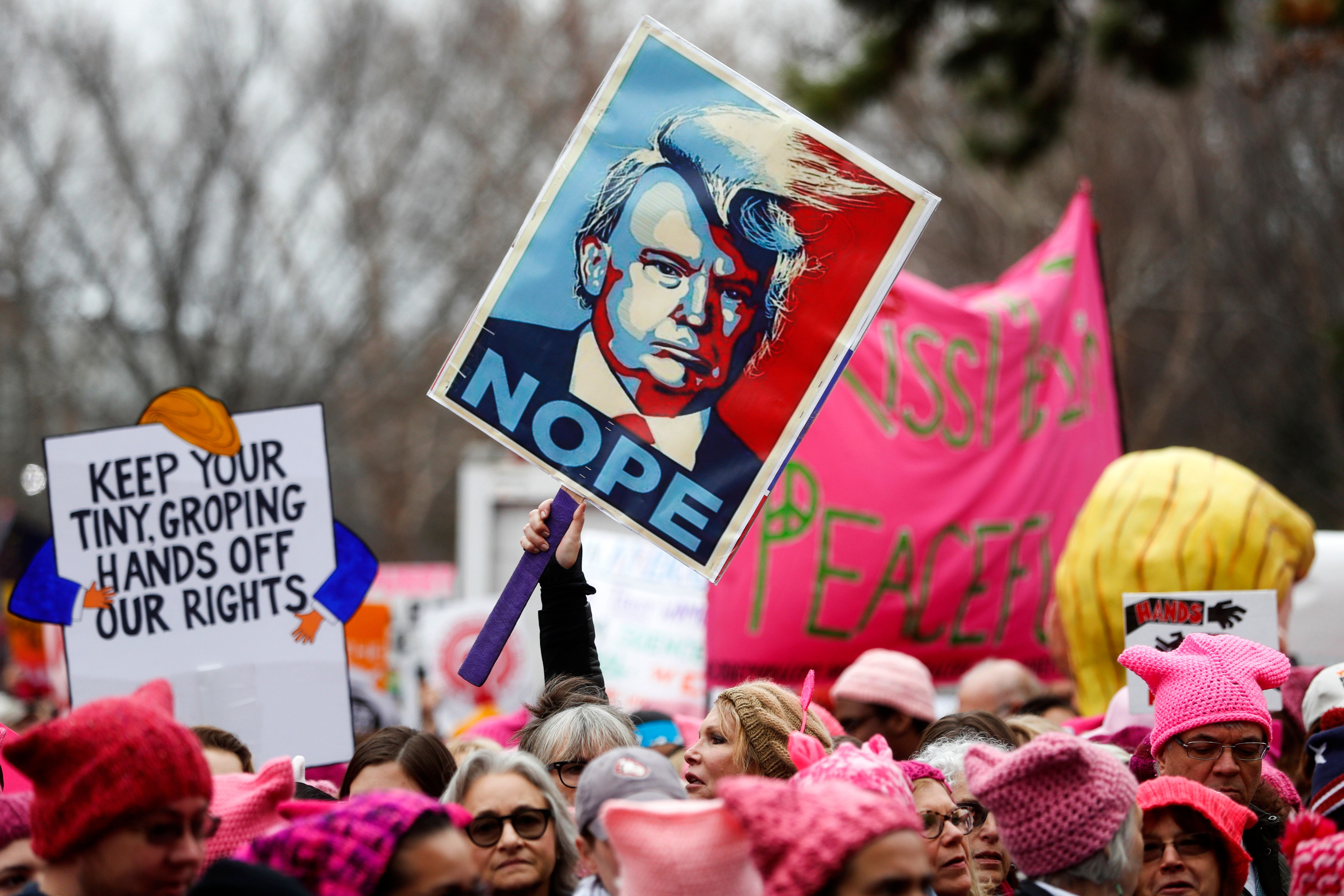 Protesters gather beside the stage at the Women's March on Washington during the first full day of Donald Trump's presidency, Saturday, Jan. 21, 2017 in Washington. Organizers of the Women's March on Washington expect more than 200,000 people to attend the gathering. Other protests are expected in other U.S. cities. (AP Photo/John Minchillo)