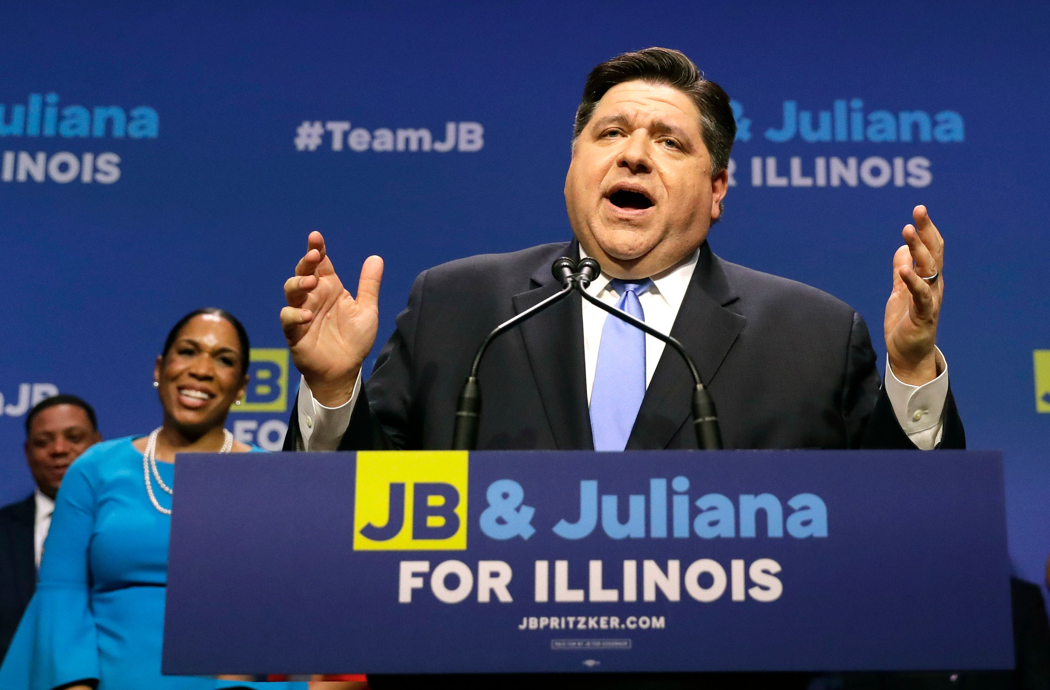 Democratic gubernatorial candidate JB Pritzker addresses the crowd after winning the Democratic gubernatorial primary over a field of five others Tuesday, March 20, 2018, in Chicago. Standing behind Pritzker is Lt. Governor candidate Juliana Stratton. (AP Photo/Charles Rex Arbogast)