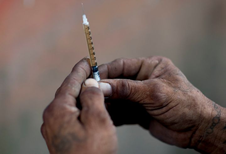 A heroin addict prepares a dose for himself in Humacao, Puerto Rico. Heroin accounted for the second highest number of a