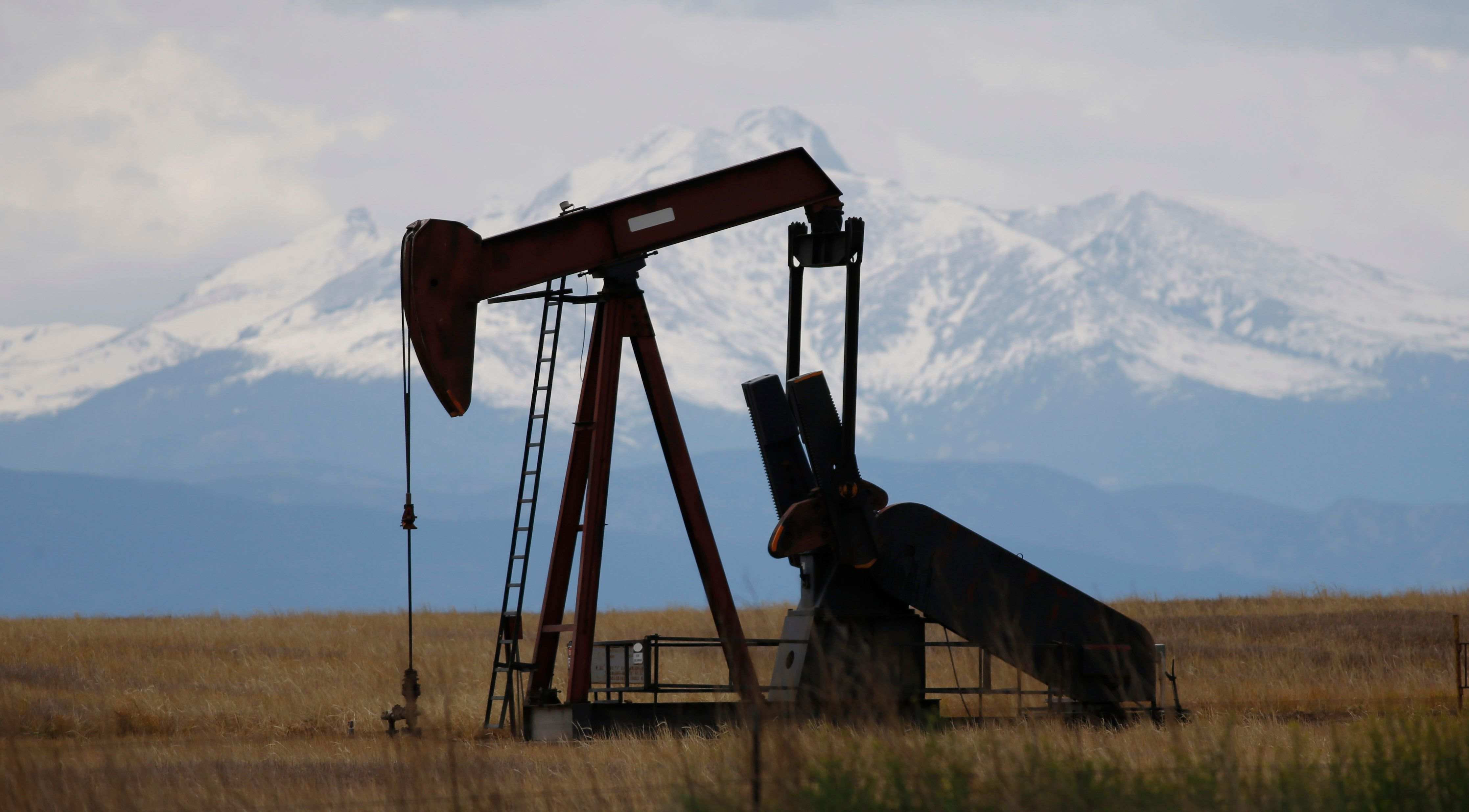 FILE - In this May 27, 2016, file photo, a pump jack works near Firestone, Colo. The Colorado Supreme Court is considering a high-stakes lawsuit over how much weight the state should give public health and the environment when regulating the oil and gas industry. (AP Photo/David Zalubowski, File)