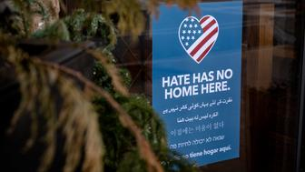 "LARCHMONT, NEW YORK -– JANUARY 13, 2019: Yard signs reading ""Hate has no home here"" have cropped up on properties across Larchmont, New York, where Proud Boys founder Gavin McInnes resides."