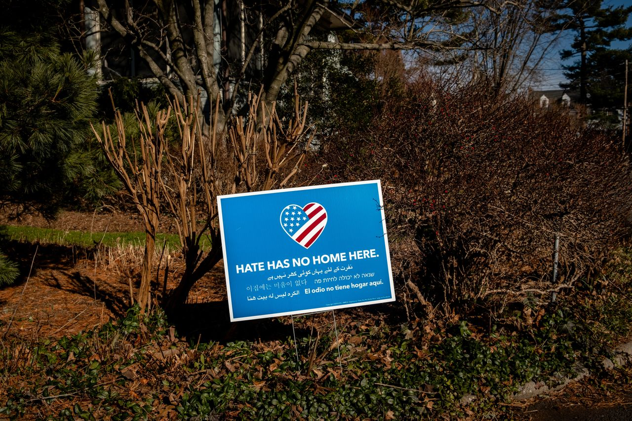 """Yard signs reading """"Hate has no home here"""" have cropped up on properties across Larchmont, New York, where Proud Boys founder Gavin McInnes resides. McInnes responded with letters critical of the signs."""