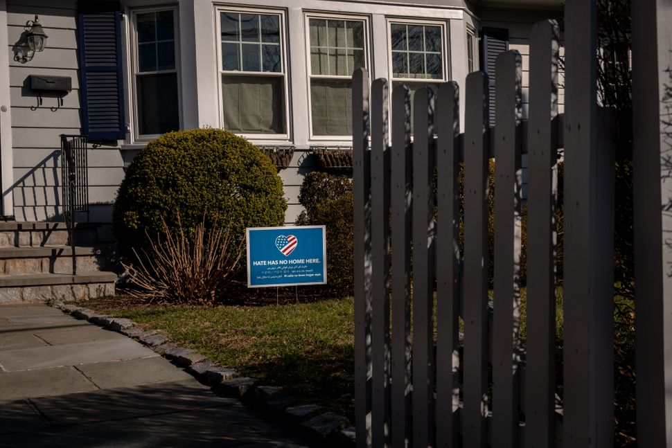 Another house in the Larchmont neighborhood with the sign.