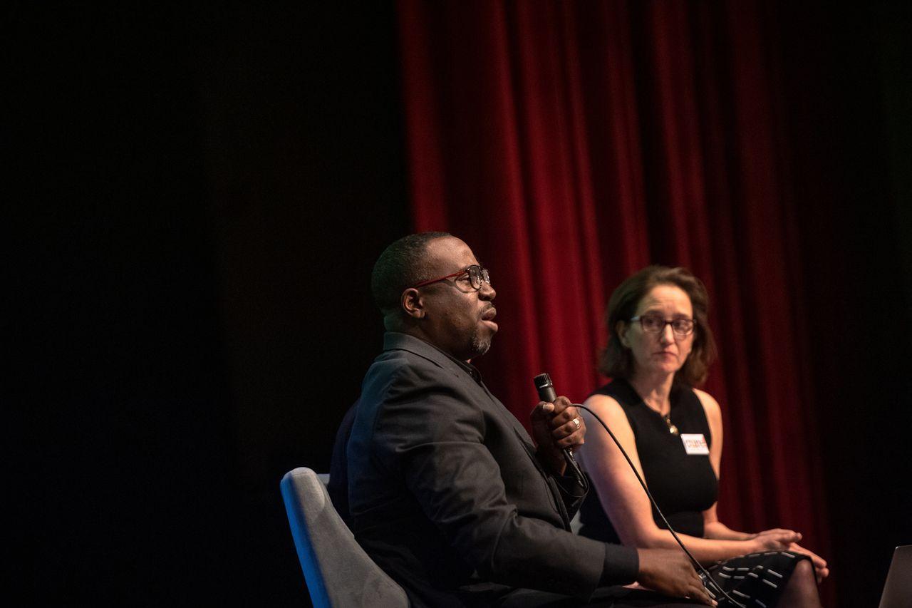 "Professor Chenjerai Kumanyika and John Biewen speak about their podcast ""Scene on Radio, Seeing White"" at the Larchmont meeting."