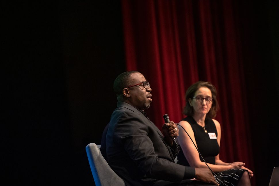"Professor Chenjerai Kumanyika and John Biewen speak about their podcast ""Scene on Radio, Seeing White"" at the Larchmont meeti"