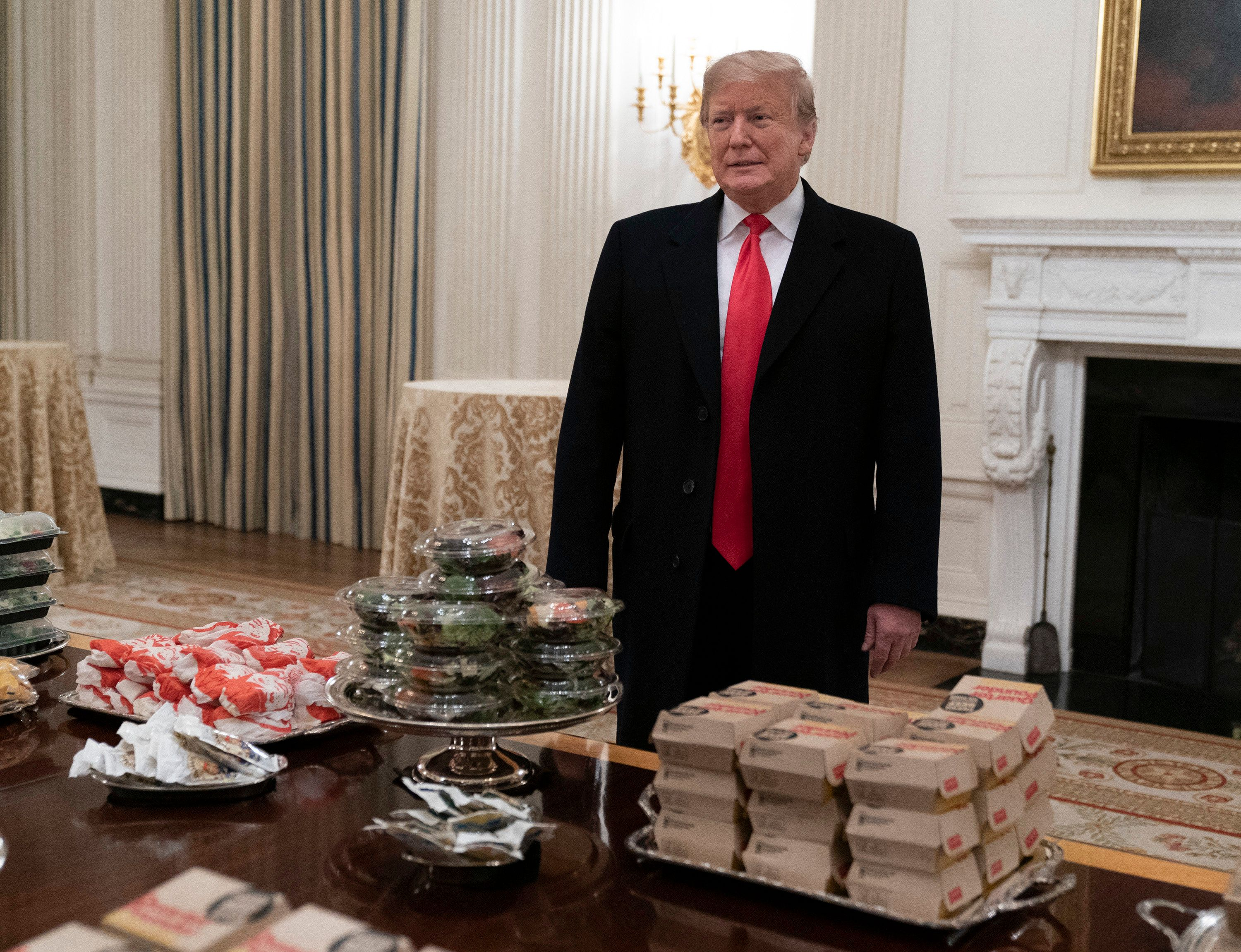 WASHINGTON, DC - JANUARY 14: U.S. President Donald Trump presents fast food to be served to the Clemson Tigers in celebration of their national championship at the White House on January 14, 2019 in Washington, DC. Clemson won their second title in three years after beating Alabama 44-16 on January 7th. (Photo by Chris Kleponis - Pool/Getty Images)