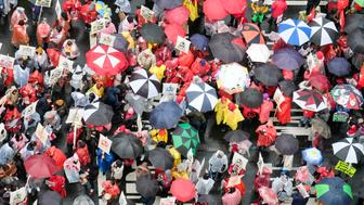 Teachers and supporters hold signs in the rain during a rally Monday, Jan. 14, 2019, in Los Angeles. Tens of thousands of Los Angeles teachers went on strike Monday for the first time in three decades after contract negotiations failed in the nation's second-largest school district, but schools stayed open with the help of substitutes and district officials said students were learning. (AP Photo/Ringo H.W. Chiu)