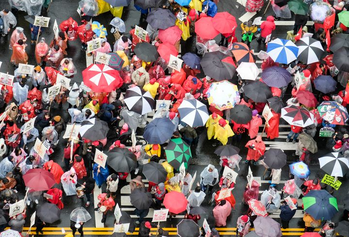 Teachers and supporters hold signs in the rain during a rally on Jan. 14, 2019, in Los Angeles.