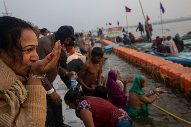 A pilgrim prays at Sangam, the confluence of the rivers Ganges, Yamuna and mythical Saraswati, during...